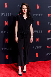 Michelle Dockery completed her look with black suede pumps.
