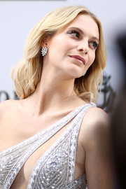 Poppy Delevingne's dangling diamond earrings and embellished gown were a gorgeous combo!