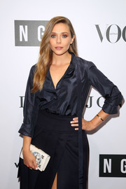 Elizabeth Olsen punctuated her blue look with a printed white clutch by Dior when she attended the NGV Gala.