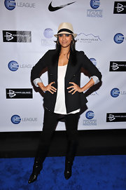 Tia Mowry struck a fierce pose in a pair of black leather knee high boots.