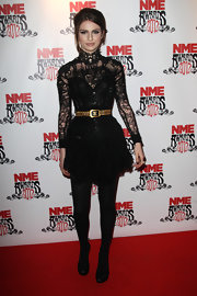 Tali Lennox wore this lacy frock with a gold belt for the NME Awards.