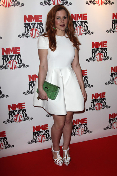 Katy B wore this structured white cocktail dress to the NME Awards.