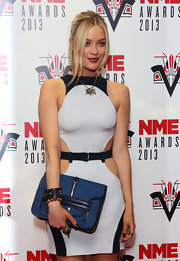 A blue canvas clutch added subtle color to Laura Whitmore's neutral outfit at the NME Awards.