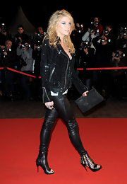 Kesha showed off her wild side at the NRJ Music Awards donning a pair of cut-out zip up ankle boots. We love her daring style and her ability to always make the craziest ensembles work.