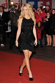 Shakira shows off her famous hips and saucy style at the NRJ Music Awards in France.