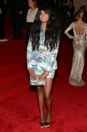 M.I.A. went a different route than most on the Met red carpet in this graphic print skirt suit.