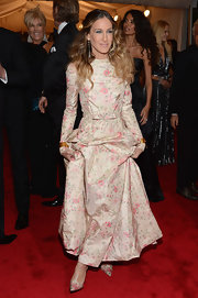 Sarah Jessica Parker paired her floral frock with Victorian gold, pearl and enamel cuff bracelets.