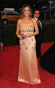 Rita Wilson  wore a simple beaded strapless satin gown to the Met Gala.