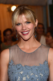 Brooklyn Decker attended the Met Gala wearing a rich cranberry shade of lipstick.