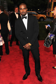 Kanye West looked dapper on the Met red carpet in this slick black ensemble.