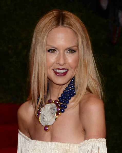 Rachel Zoe attended the Met Gala wearing a glamorous statement necklace featuring yellow gold, diamonds, carved rubies, antique carved jade and lapis beads.