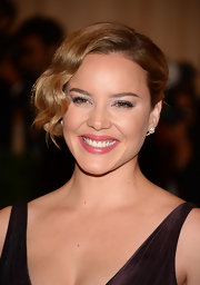 Abbie Cornish looked lovely at the Costume Institute Gala wearing her long wavy bangs swept to the side.