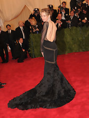 Renee Zellweger loves a great backless dress like this fanciful trained black gown she wore to the Met Gala.