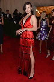 Milla Jovovich's gorgeous red and black gladiator-esque gown featured wide fringe and unique beading.