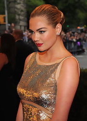 Kate Upton slicked her golden hair back into a sleek knot for the Costume Institute Gala at the Met.
