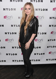 Avril Lavigne opted for gold and black metallic pants for her look at the launch of the her NYLON cover.