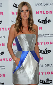 Nicky Hilton wore a strapless cocktail dress to the NYLON launch party in Los Angeles. She finished off the look with shiny waves and a sun-kissed glow.