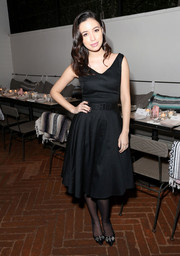Christian Serratos continued the vintage feel with a pair of bedazzled and bowed satin pumps.