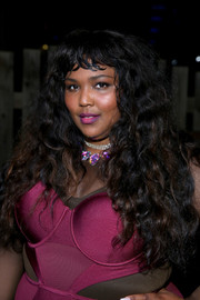 Lizzo attended the SXSTYLE event wearing a long curly 'do with baby bangs.