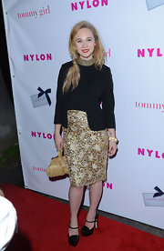 Black patent leather Mary Jane platform pumps added extra inches to Juno Temple's petite frame at the NYLON Magazine Hollywood Issue party.