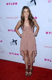 Nikki Reed stepped out to celebrate 'Nylon' magazine's young Hollywood issue wearing a sexy pair of strappy bronze sandals.