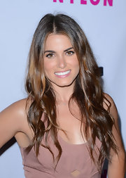 Nikki Reed kept her glossy tresses in casual long layers while attending 'Nylon' magazine's annual young Hollywood celebration.