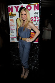 Kristine paired her denim jumpsuit with a straight, side-parted hairstyle.