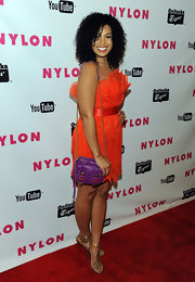 Jordin Sparks' purple snakeskin purse popped against her bold orange frock.