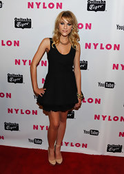 Brit looks chic in a sweet fit and flare LBD for the Nylon Young Hollywood party.