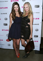 Candice Accola's red and black velvet tote added a vintage feel to her edgy ensemble at the Nylon Magazine party.