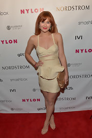 Haley Strode chose this gold peplum cutout dress for her chic and contemporary red carpet look.