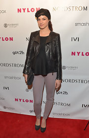 Alexis Knapps distress leather jacket gave her a cool biker-chick look on the red carpet.
