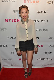 A pair of lacy black short shorts kept Savannah's red carpet look feminine and polished.