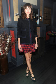 Alexa Chung teamed strappy black pumps with a tweed jacket and a print dress for the Nylon October issue party.