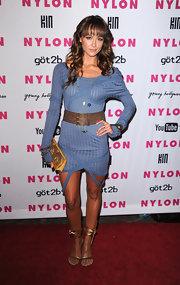 Sharni wears gold ankle-wrap evening sandals for the Nylon Young Hollywood party.