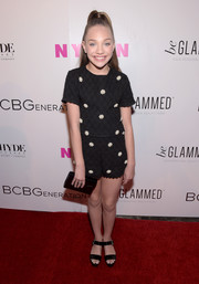 Maddie Ziegler kept the black theme going with her Jimmy Choo clutch.