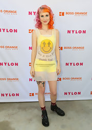 "Hayley Williams stuck to her signature punk style with this sheer shopping bag-inspired dress that reads, ""Have a Nice Day.'"