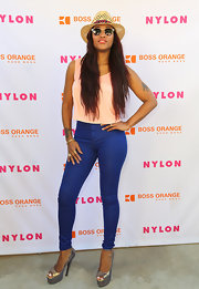 Eve teetered on a pair of silver platform peep-toes at the Nylon x Boss Orange Escape House.