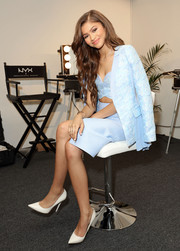 Zendaya Coleman suited up in sexy style in this pastel-blue Lie Sangbong ensemble, consisting of a jacket, skirt, and bustier, for BeautyCon LA.