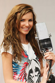 Nadine Coyle looked adorable in a long wavy cut during a portrait session in London.