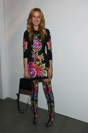 Petra Nemcova punctuated her florals with a simple black leather purse.