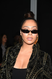 La La Anthony wore her hair in a tight top knot at the Naeem Khan fashion show.