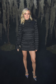 Kristin Cavallari brightened up her look with a pair of silver cross-strap pumps by Alexander White.