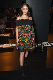 Cara Santana slipped into a floral-embroidered paperbag dress by Naeem Khan for the brand's fashion show.