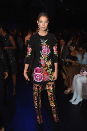 Hannah Jeter went matchy-matchy with this floral-embroidered boots and dress combo by Naeem Khan.