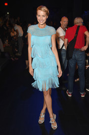 Petra Nemcova channeled the roaring '20s in a fringed sky-blue cocktail dress by Naeem Khan during the brand's fashion show.