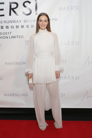 Leighton Meester looked angelic in a long-sleeve white blouse at the Naersi fashion show.