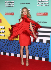 Natalia Vodianova completed her sassy red carpet look with gold triple-strap heels.