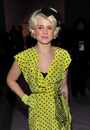 Kelly Osbourne showed off her neon green lace glove while attending Fashion Week in Bryant Park. Her gloves were a nice touch to her neon polka dot dress.