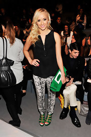 Nastia Liukin showed off her classic but fun style with snakeskin skinny pants and bright green accessories.